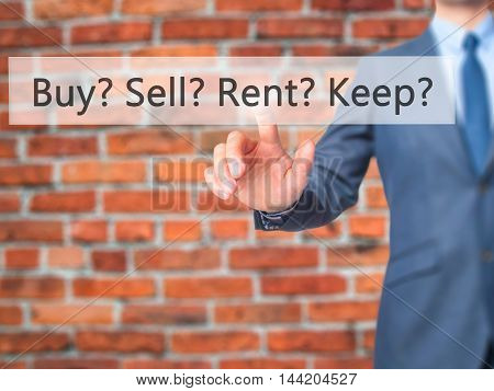 Buy? Sell? Rent? Keep? -  Businessman Click On Virtual Touchscreen.