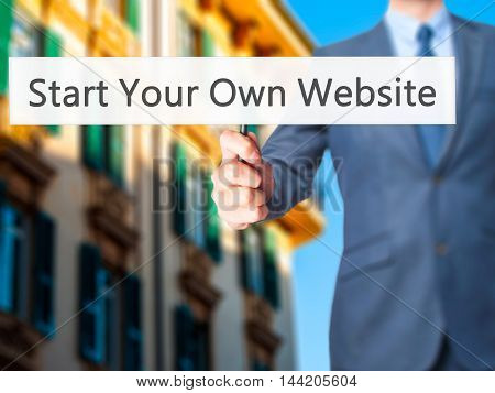 Start Your Own Website - Business Man Showing Sign
