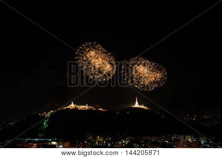 Fireworks at Kao Wang mountain over the cityscape of Petchburi