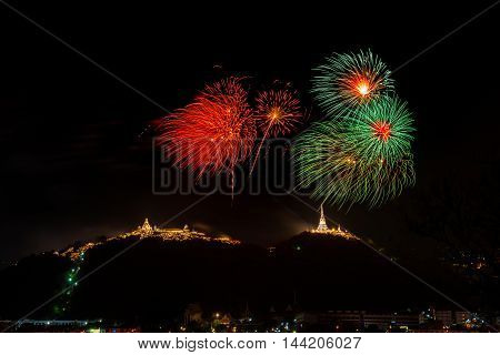 Fireworks at Kao Wang mountain over the cityscape of Petchburi Thailand