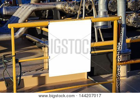 billboard blank for advertising poster at yellow tube on industrial background