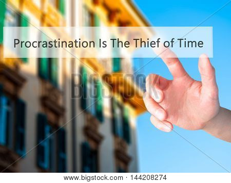 Procrastination Is The Thief Of Time - Hand Pressing A Button On Blurred Background Concept On Visua