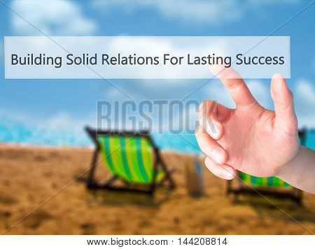 Building Solid Relations For Lasting Success - Hand Pressing A Button On Blurred Background Concept
