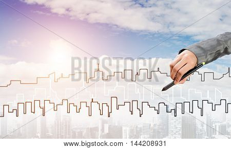 Hand of man designer drawing with stylus construction project