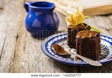 Chocolate brownie with zucchini on a rough wooden background. Proper nutrition. Healthy eating . Selective focus