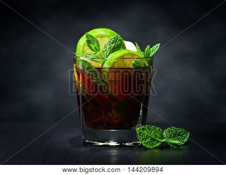 Cocktail Cuba Libre With Lime And Peppermint Leaves