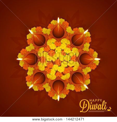Creative beautiful Rangoli made by flowers with Illuminated Oil Earthen Lamps, Vector greeting card for Indian Festival of Lights, Happy Diwali Celebration.