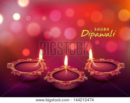 Beautiful floral, Illuminated Oil Lit Lamps on shiny blured background for Indian Festival of Lights, Happy Diwali Celebration.
