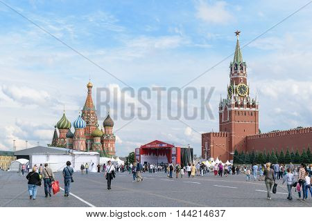 Moscow, Russia - July 07, 2016: People walk near a temporary stage built on the Red Square