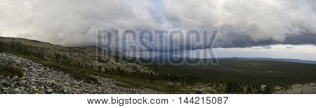 The panoramic view of the Northern Urals with gloomy sky