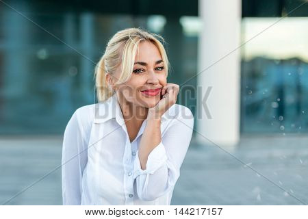 Beautiful woman in white shirt with surprise emotions on the street - close up portrait
