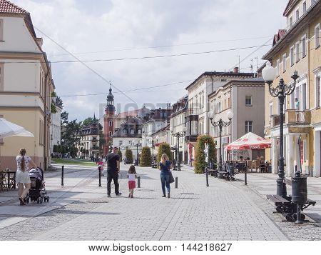 JELENIA GORA POLAND - AUGUST 14 2016: Tourists Walking Through Historic Downtown in Warmbrunn Jelenia Gora Poland