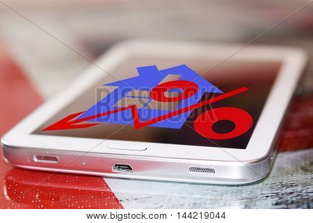 Red percentage sign and house on your phone screen . The concept of online rating of real estate .