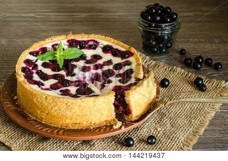 tart with cottage cheese and berries on burlap cloth, wooden table