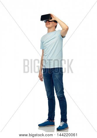 3d technology, virtual reality, entertainment, cyberspace and people concept - happy young man with virtual reality headset or 3d glasses