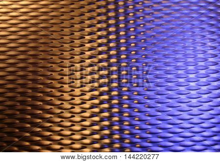 colored reflexes of steel in blue and gold