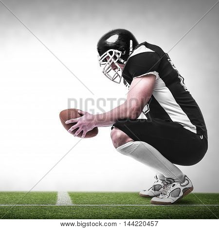American football player on the football pitch.