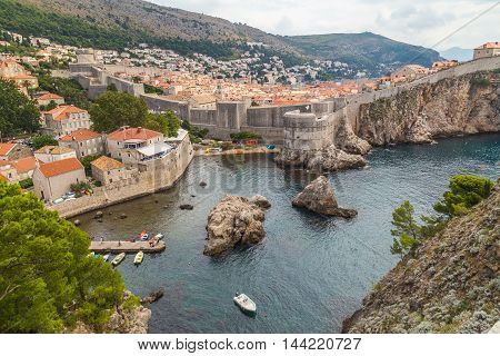 DUBROVNIK CROATIA - 11TH AUGUST 2016: A view towards Old Town Dubrovnik during the day in the summer showing the outside of the walls and buildings