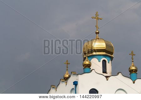 Partly finished construction of an orthodox church in the city Holic Slovakia. Golden shiny domes and three crosses.