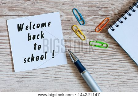 School supplies on teacher or pupil workplace background. Welcome back. Educational concept.