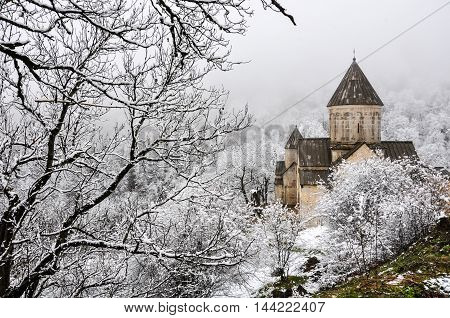 Haghartsin Monastery near small town Dilijan in Armenia. Hidden in winter forest covered with snow.
