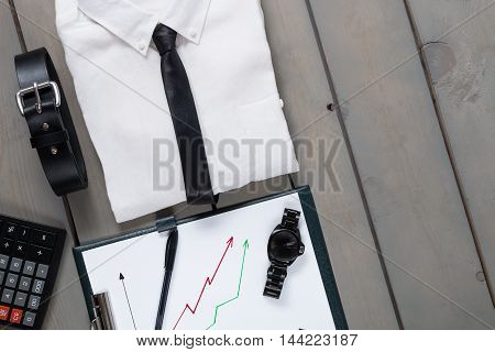 Businessman, Work Outfit On Grey Wooden Background. White Shirt With Black Tie, Watch, Belt, Planche