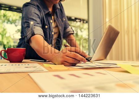 businesswoman analyzing investment charts. Accounting Bussiness concept soft focus vintage tone