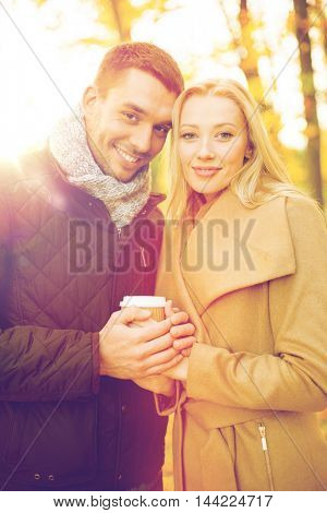 holidays, love, travel, tourism, relationship and dating concept - romantic couple in the autumn park