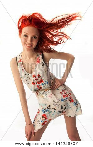 Red-haired Girl In Shorts Isolated On White Frne