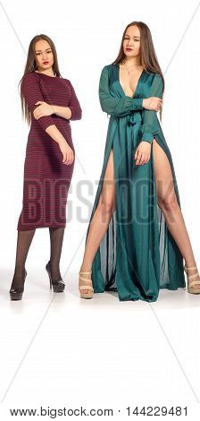 pretty girls. contrast modest and sexuality. modest girl sexy dress standing in the open. Sisters - twins