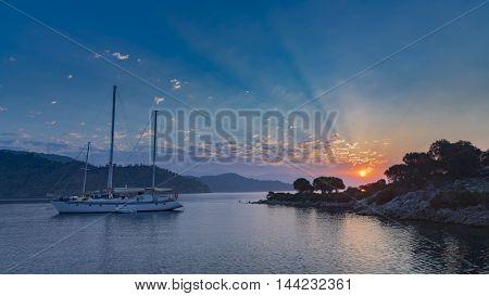 Yacht and the rising sun in Mediterranean Sea Turkey