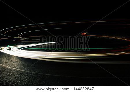 Exposured bright red and white lines from car riding on night road