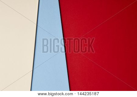 Colored cardboards background in beige blue red tone. Copy space. Horizontal