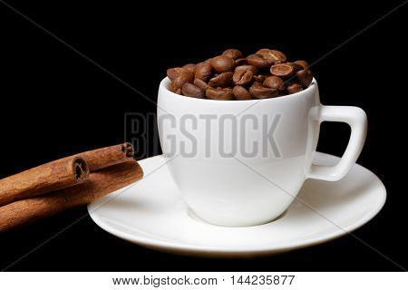 Coffee Cup Full Of Coffee Beans And Cinnamon Sticks