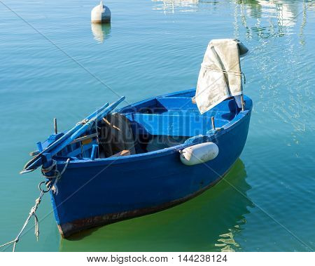 Typical fishing rowboats called gozzo in little port of Giovinazzo Apulia - Italia