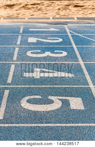 white numbers on the blue track, from six to one
