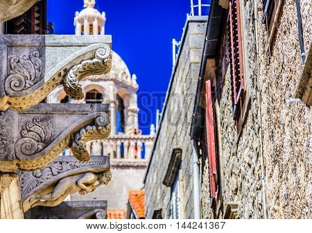 View at architecture details of old city center in town Korcula with St. Mark's Cathedral in background, Croatia.