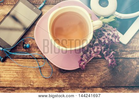 Still Life With Tea Cup And The Contents Of A Work Space Composed. Different Objects On Wooden Table