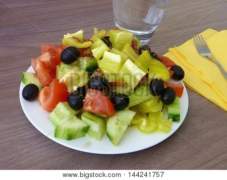 Fresh Healthy Vegetable Salad Served On A White Plate