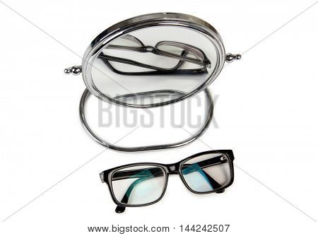 Mirror and glasses on a white background