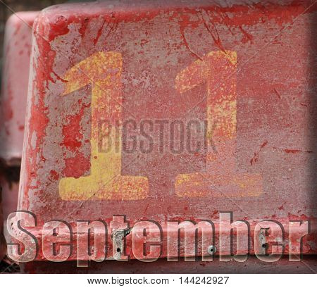 the figure eleven on a red shabby background. the inscription