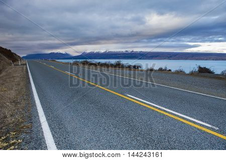 asphalt highway in aoraki - mt.cook national park new zealand