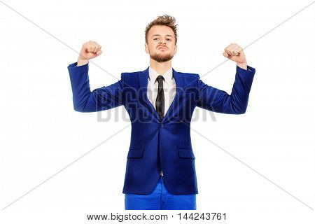 Comic businessman shows his strength. Isolated over white.