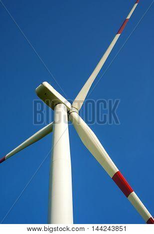 detail of wind turbine in blue sky