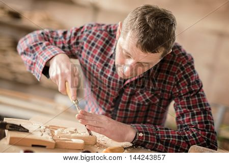 Shot of a male carpenter working on a project in his workshop.