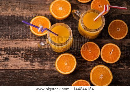 Fresh Half Cut Oranges On Wooden Table