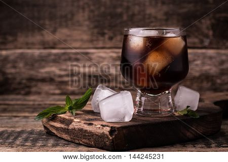 Cold Drink With Ice On Wooden Vintage Table
