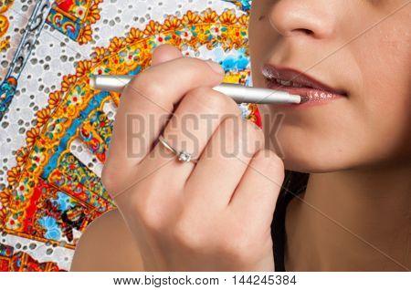 Girl Paints Her Lips