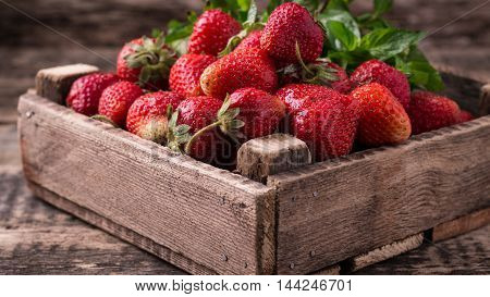 Fresh Strawberries In The Box On Wooden Vintage Table