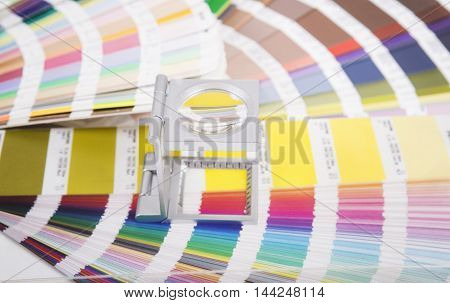 Lens. Production of printed materials. Prepress concept.